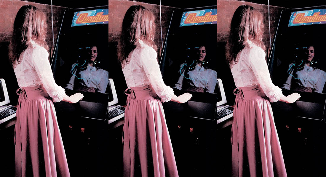 Betty Tylko in front of her arcade game, Quantum.