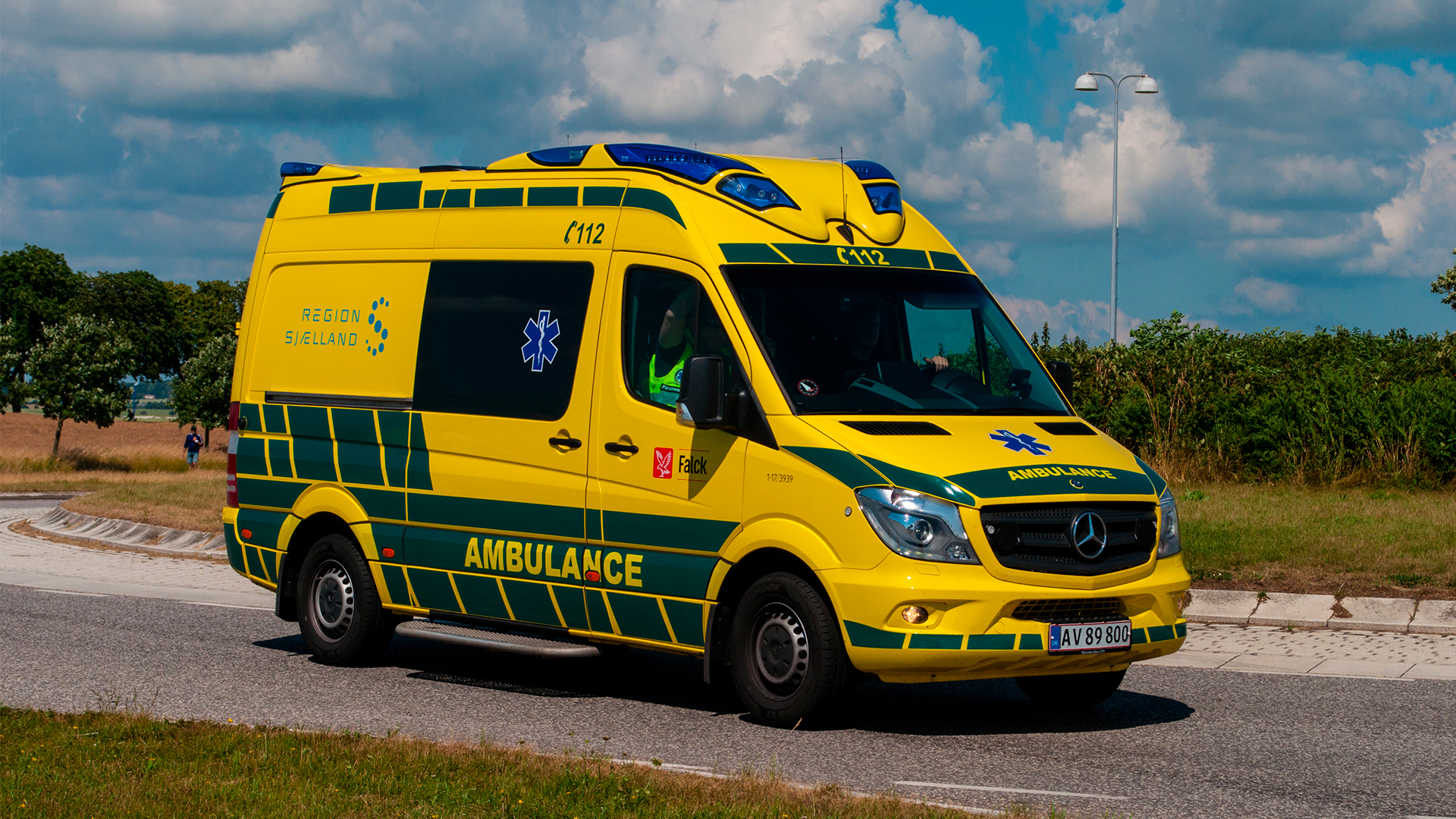 Ambulance drives on the road